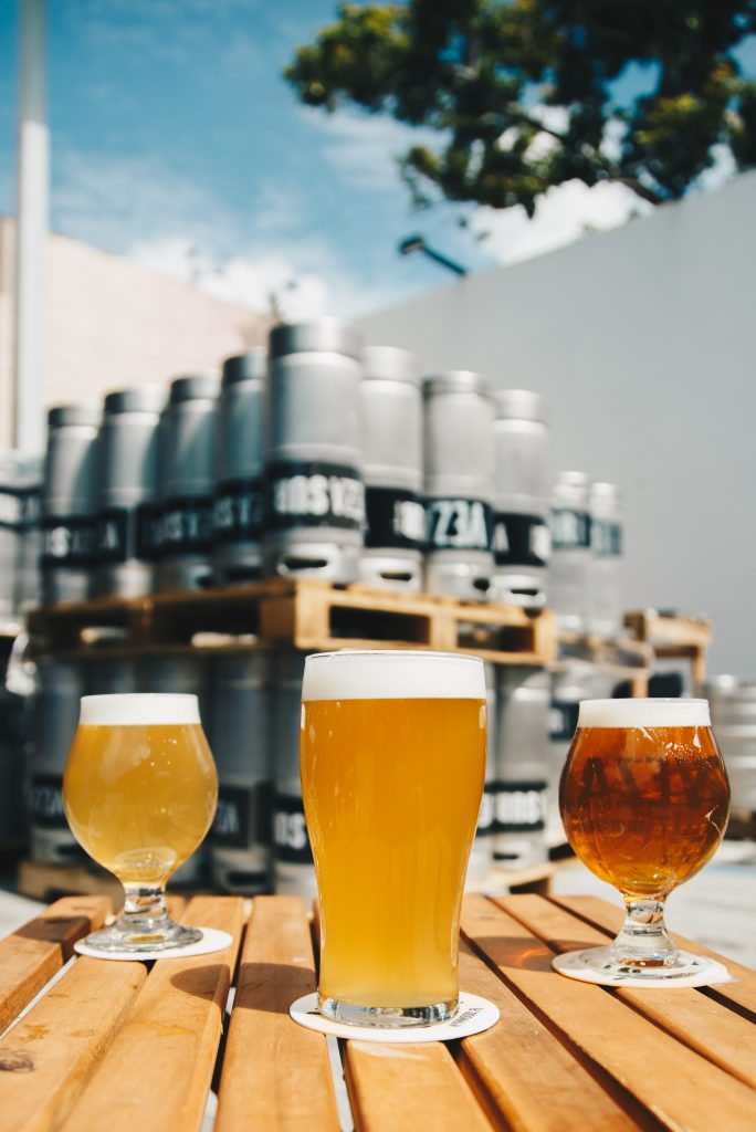 beers on a table at a brewery